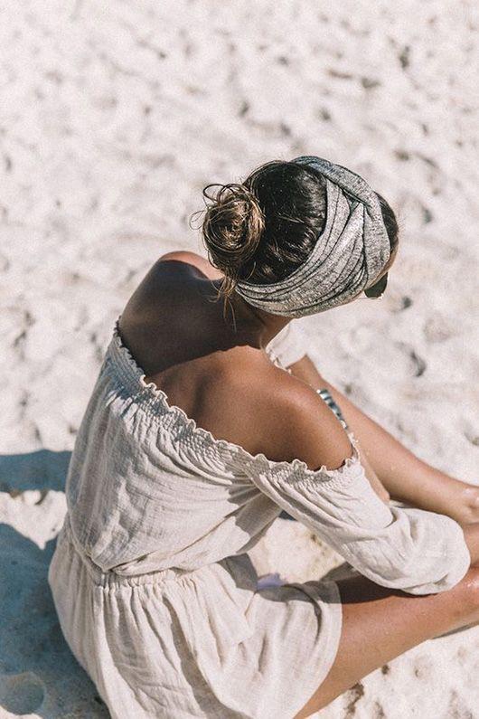model on the beach wearing gray head scarf / sfgirlbybay