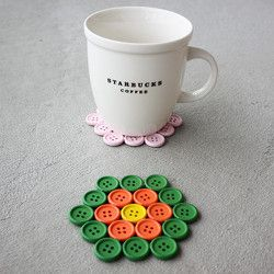 Make your own button coasters with this easy DIY. All you need is buttons and glue!