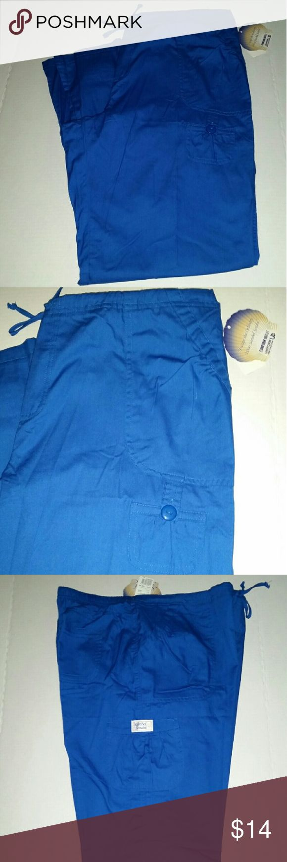 L NWT SANIBEL SCRUBS flare leg scrub pants blue Sanibel scrubs cute royal blue flare scrub pants Cute gathered detail around the pockets. Two back pockets. Drawstring waist with elastic Size Large 55% cotton, 45% polyester  Style# SA331 New with tags  *If interested I do have the matching top Size x-large & lab coat Size large also listed.* sanibel scrubs  Pants