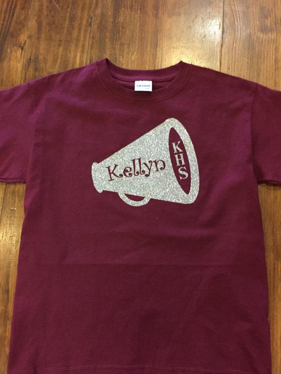 Customize this shirt to say ANYTHING you want it to say! Shown in the picture is a Silver Glitter Megaphone on a Maroon Tee Shirt. The
