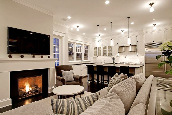 open concept kitchen living room living room traditional with recessed lighting traditional artificial flowers
