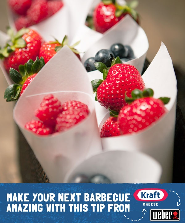 Roll up simple paper cones and fill them with red and blue berries to give guests a healthy, sweet treat.