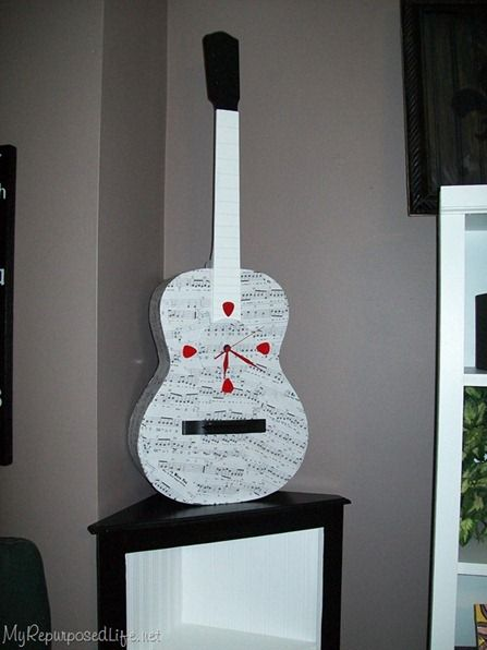 Old guitar upcycled into a clock- Andrew would love this idea!