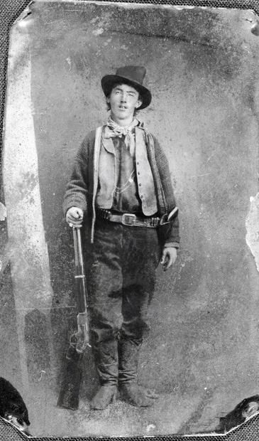 The only known photograph in existence of Billy the Kid is the one above. (The tin-type recently sold for more than $2 million; any other purported photo of the Kid is a look-a-like fake). It is in fact a reverse image - the Kid was holding his rifle with his left hand when photographed.