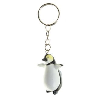 Novelty Penguin Keyring.  Dimensions: Total Length 9.5cm Penguin Height 4cm Width 3.5cm Depth 2cm  Delivery prices available on Checkout