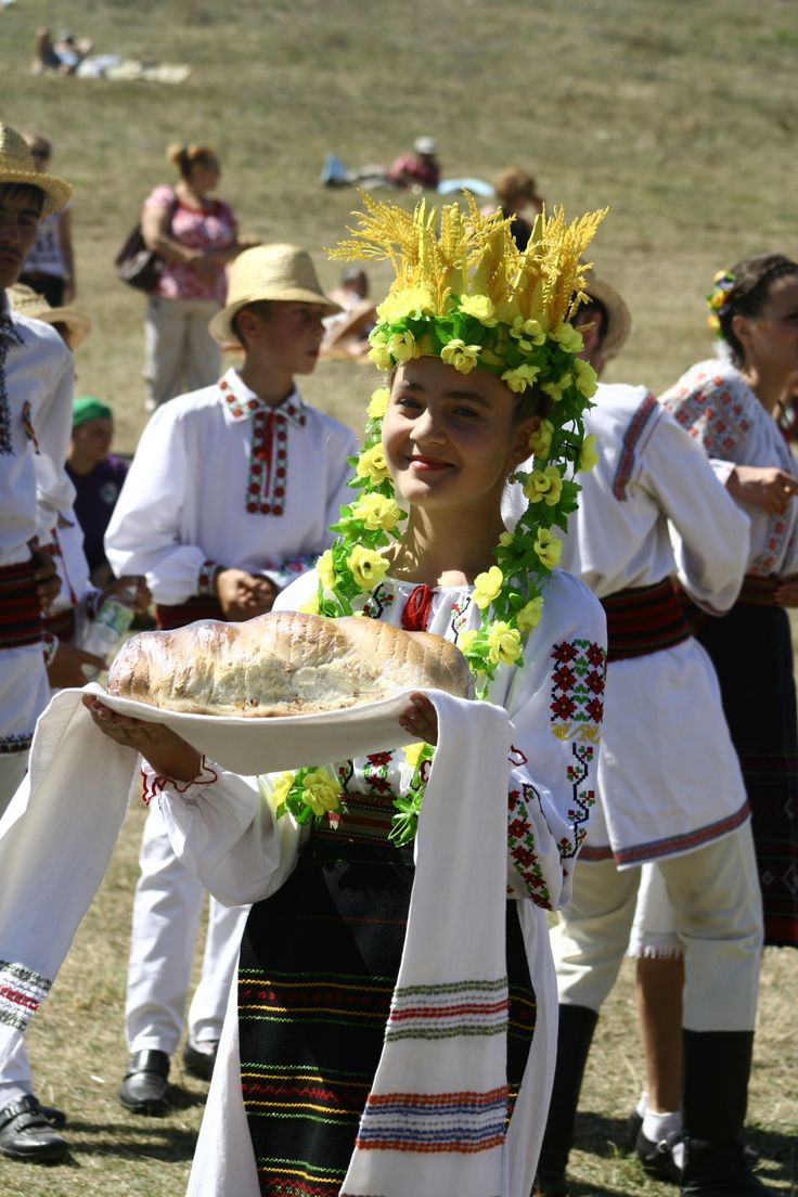 Moldova....Bread and Salt and traditional clothes at a festival in Moldova.