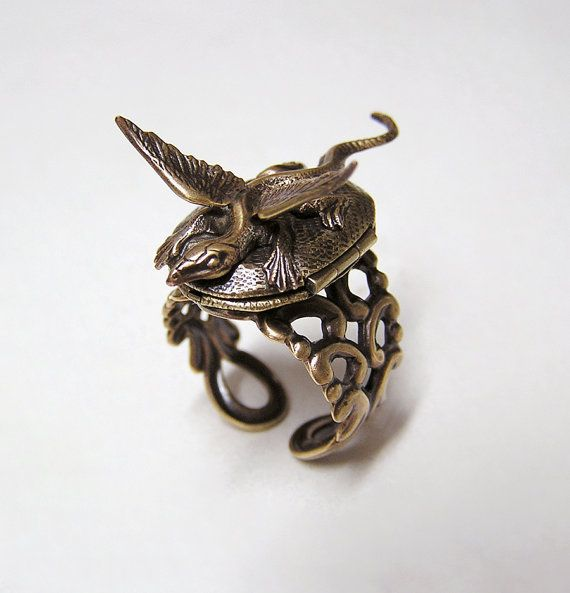 This forest dragon just landed and is resting comfortably on a woven vintage locket. Comfortable to wear day and night. The locket opens... -- This is amazingly awesome.