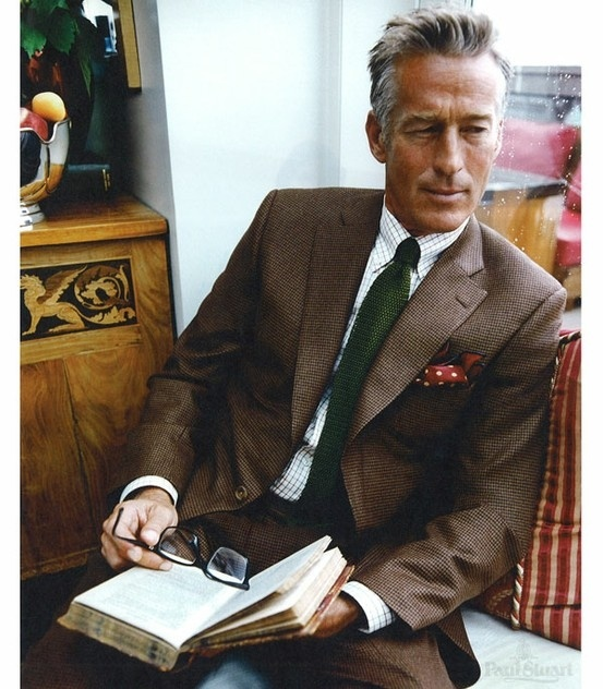 I don't know which I appreciate more: the suit (and it's grabbing emerald tie) or the Rex Harrison-like model.