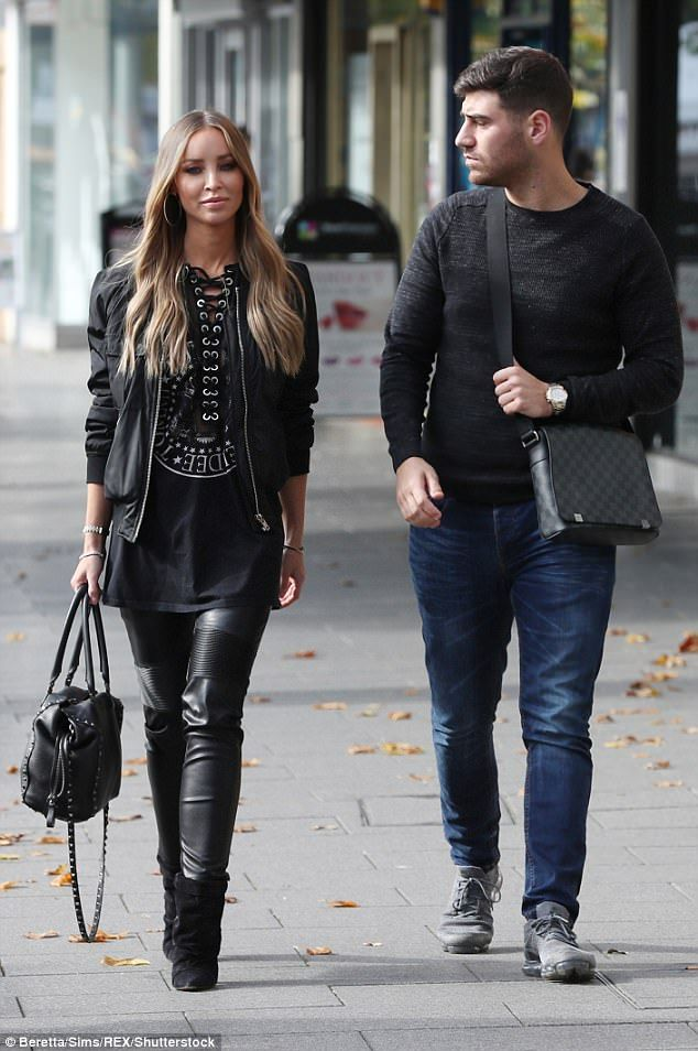 Happy: Lauren Pope and Jon Clark looked loved-up as they stepped out for a romantic stroll while filming The Only Way Is Essex on Monday
