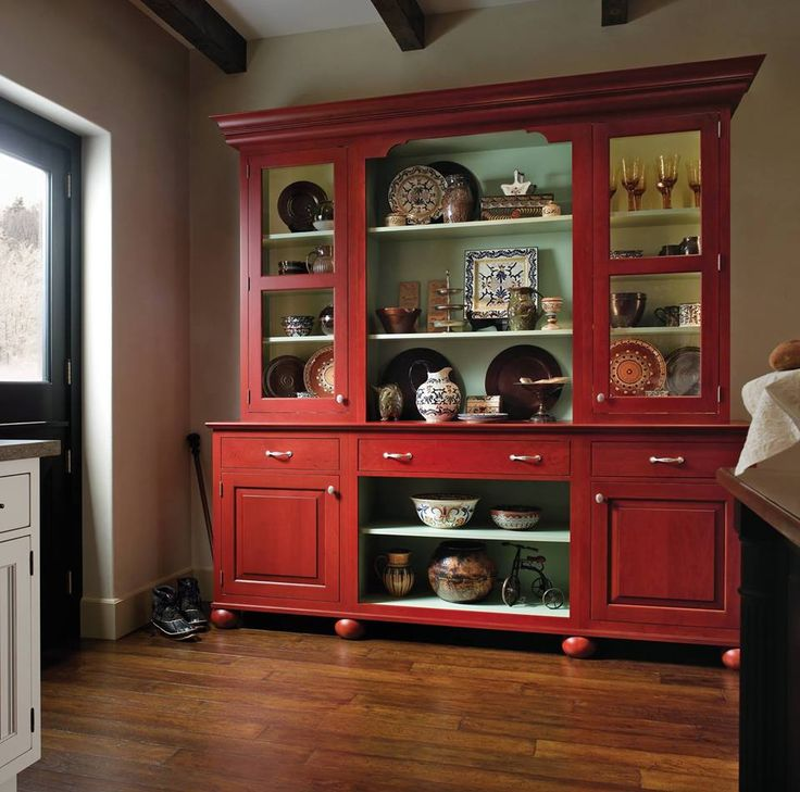 a colorful accent piece can lighten up any room especially this red with blue detail