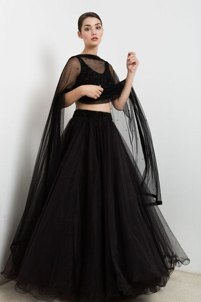 DETAILS. Black embroidered blouse and tulle lehenga set. SIZING. Once your order is placed we will send you an email regarding all the measurements that are required for your custom made outfit. Generic sizing is also available. For more information please contact info@waliajones.com.