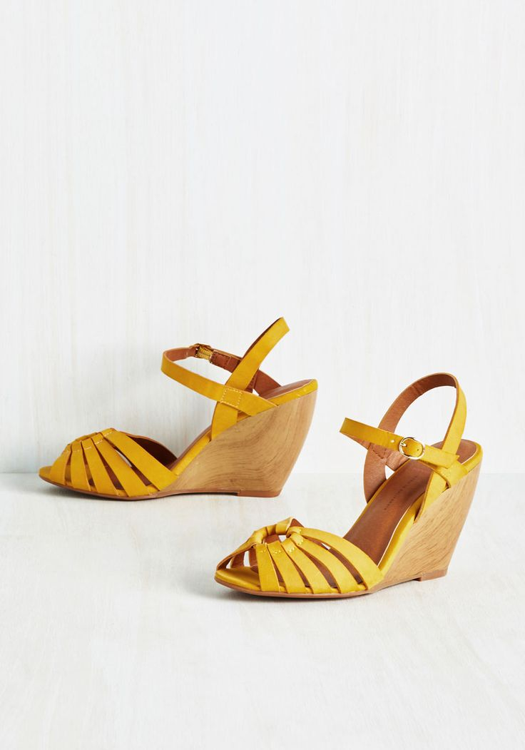 Piazza Pizzazz Wedge in Saffron. Heads turn and spirits lift when you strut through the city square in these muted yellow wedges! #yellow #modcloth