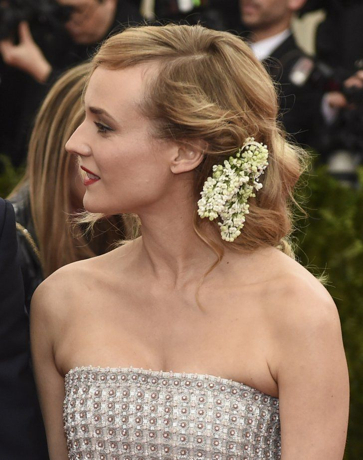 Pin for Later: Zoom In on Every Gorgeous Hair Accessory From the Met Gala Diane Kruger A few fresh blooms completed Diane's upswept Met Gala style.