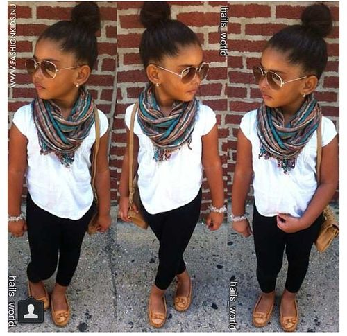Cute casual kids outfit idea. White t shirt, printed scarf with black skinny jeans and brown sandals.