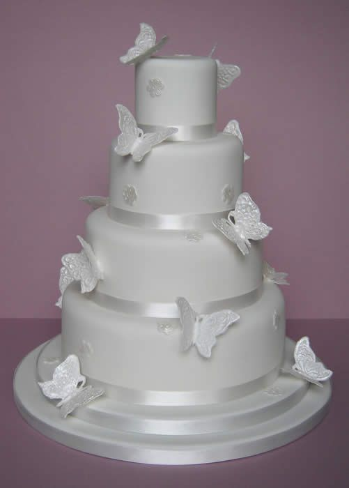cakes | ... sugar butteflies and applique lace blossoms return to wedding cakes