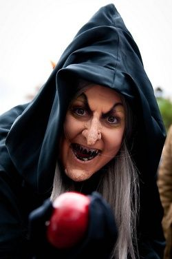 The Evil Queen in disguise as a, witch hag from Snow White.