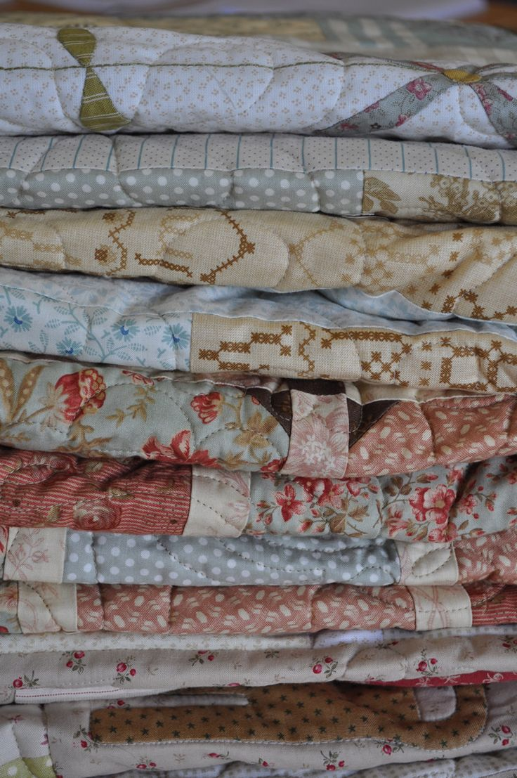 Stacks of quilts look so...enticing