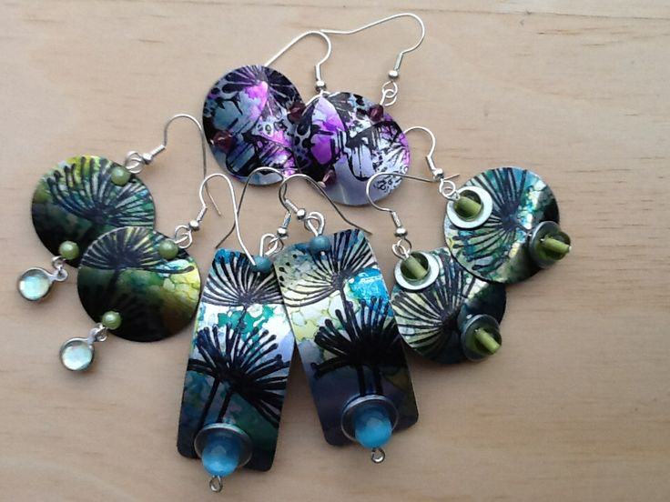 Aluminium drink cans, alcohol inks, stamping and washers used to make earrings