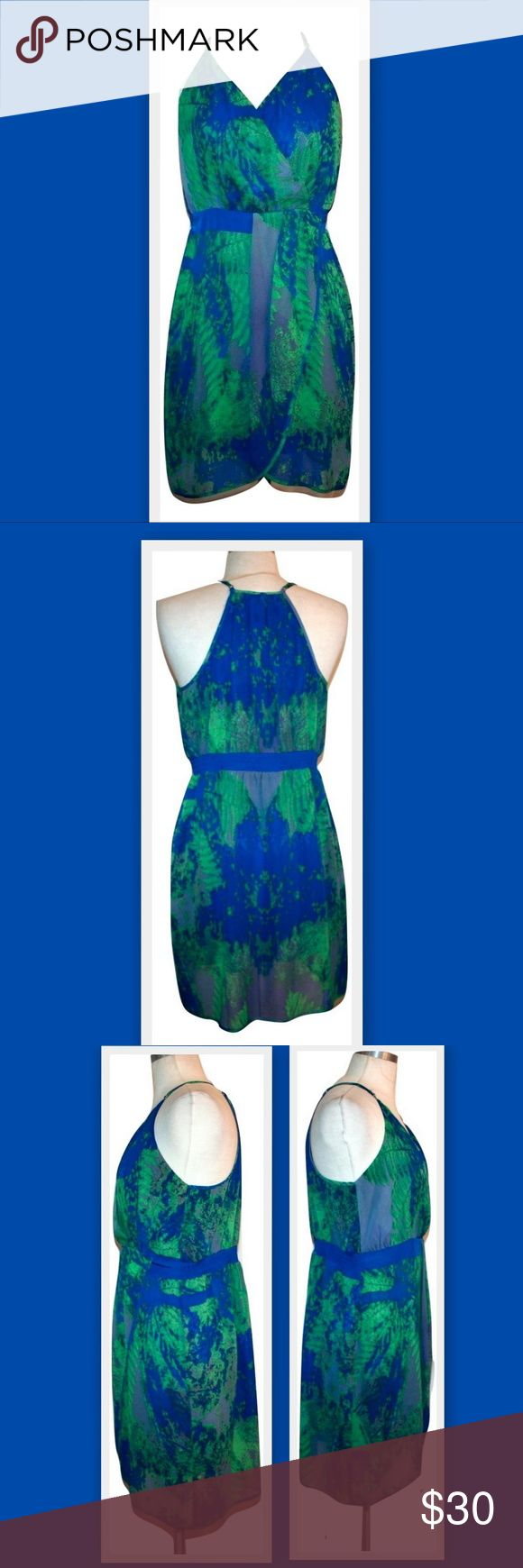 """Charlie Jade Faux Wrap Dress Charlie Jade dress. Abstract leafy pattern in blue and green. Faux wrap bodice and tulip skirt. Elastic waist across the back. Lining is slightly shorter than the top layer, showing a peek of the thigh. Adjustable straps. The last photo shows the same dress in a different print on a model.  100% polyester  Marked size M Bust 42""""  Elastic Waist 29"""" (stretches to about 35"""") Hips 44"""" Length 36"""" Charlie Jade Dresses"""