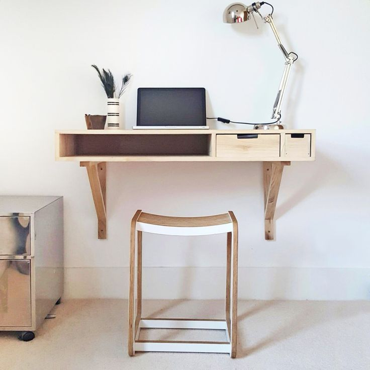 "upercharge your living space with our wall mounted desk  Wall mounted desk that's a neat solution to freeing up space in your living space. It's a good size at 100cm. x 50cm making it ideal for teenagers homework, ""working from home"" or just to Facebook stalk old school friends.  This solid wood desk is big enough to comfortably work on, but small enough to fit in  It comes with two practical drawers and a storage area for a keyboard."