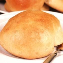 This recipe is for great dinner rolls that can also double as sandwich bread. An egg white wash ensures a golden crust.