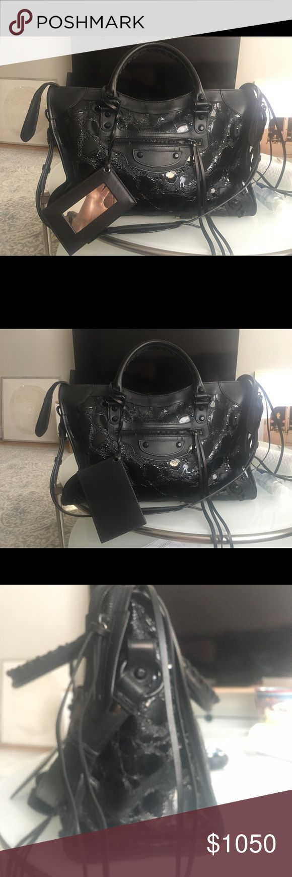 Balenciaga Classic City Satchel Embossed calfskin leather, double whipstiched rolled handles, solid leather trim and accents, zip pocket at front, buckle and metal stud accents with hanging leather framed mirror Balenciaga Bags Satchels