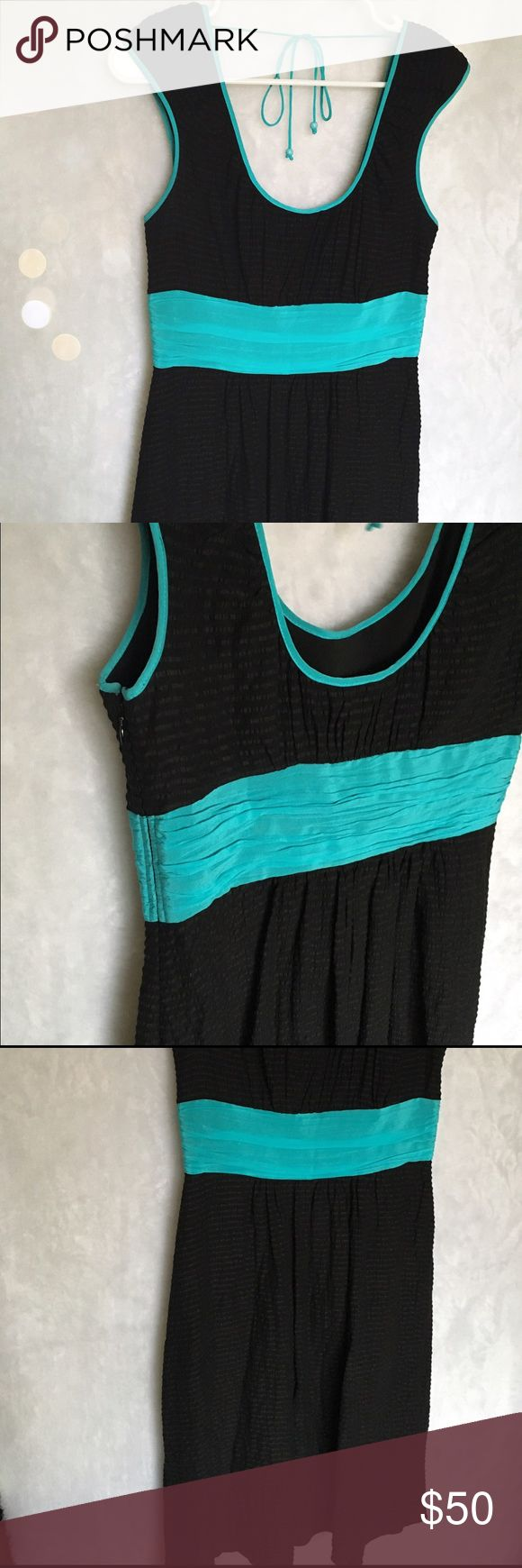Tracy Reese dress Frock! By Tracy Reese Black and turquoise dress. Silk/linen/spandex. Subtle black stripes throughout the dress. Zipper on the side. So cute! Tracy Reese Dresses