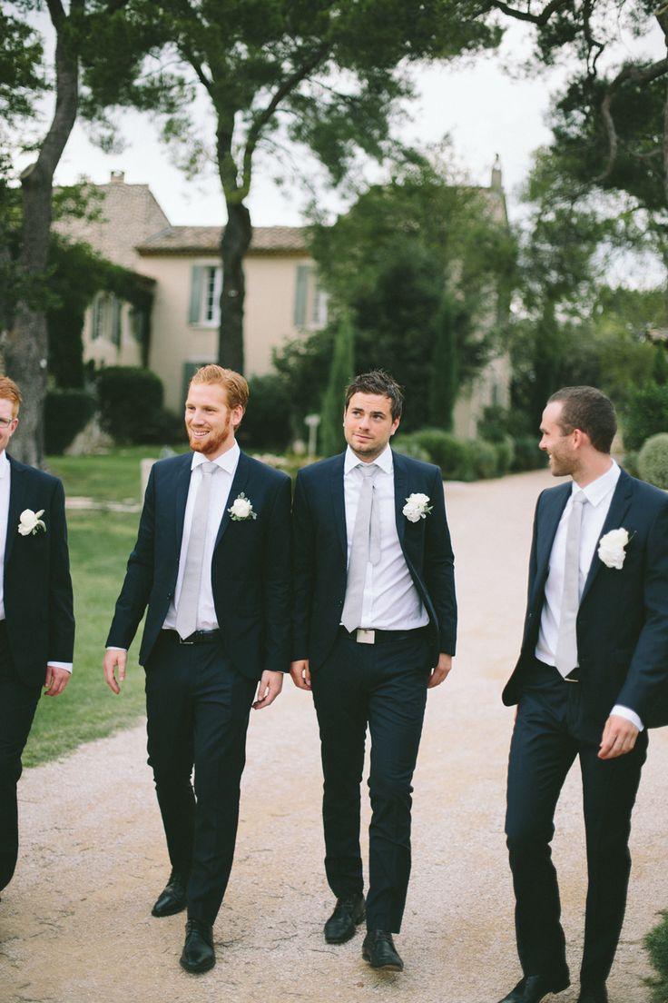 Black Suits with silver ties - Image by M&J Photography - A destination wedding in Provence with a lace gown and groom in blue suit. White on white colour scheme. Photography by M&J Photography.