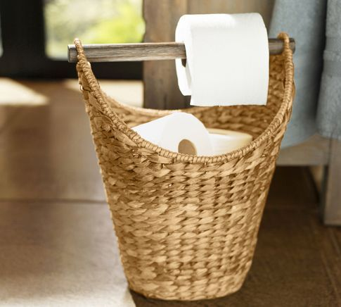 Hmmm....someone took the toilet paper holder out of the new house...Great idea.