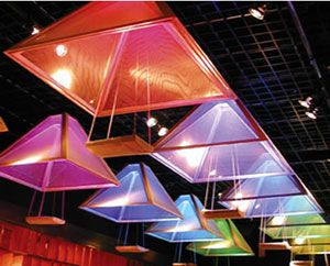 Pyramid-like fixtures used in a lounge. This system can change color in unison or show asynchronous effects,