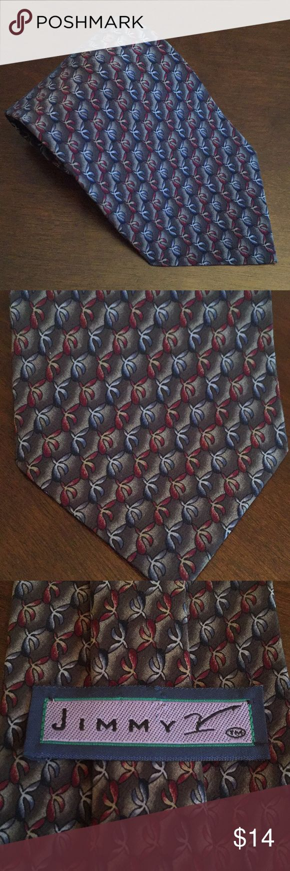 Jimmy V necktie Great necktie from the Jimmy V Collection.  Original purchase price helped raise funds for cancer research thru The V Foundation.  Dark grey with a red and light grey geometric pattern throughout the tie. Very good condition. Accessories Ties