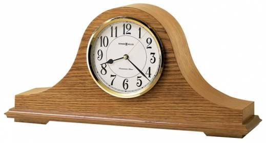 635100 HowardMiller Quartz Single chime fireplace Oak Mantel Clock NICHOLAS-Howard Miller traditional mantel clock off-white dial offers a convex glass crystal, polished brass finished bezel, black Arabic numerals and brass second hand.