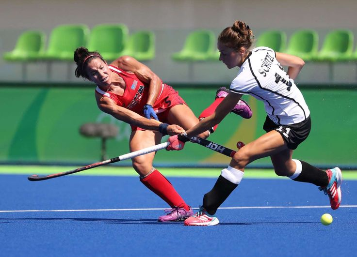 Melissa Gonzalez of the United States passes the ball against Lisa Schutze of Germany during a women's hockey quarterfinal match in the Rio 2016 Summer Olympic Games at Olympic Hockey Centre.      -  Best images from Aug. 15 at the Rio Olympics:  2016