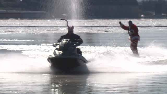 Below-freezing temperatures did not deter three brave water skiers from raising money for a local charity.