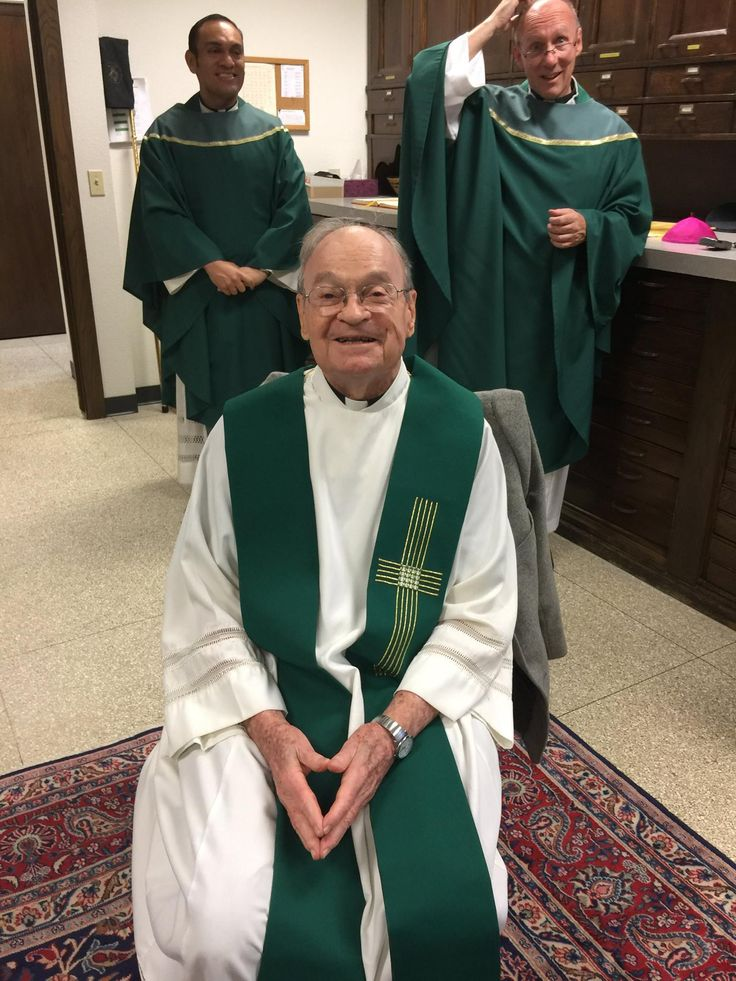 Paulist Fr. John Kenny (seated at front) in the sacristy of the Cathedral of St. Andrew in Grand Rapids, MI, on Oct. 14, 2017, prior to the 70th anniversary Mass for the Catholic Information Center in Grand Rapids.  Behind him are Paulist Fr. Rene Constanza (left) and Paulist Fr. Bill Edens (right).