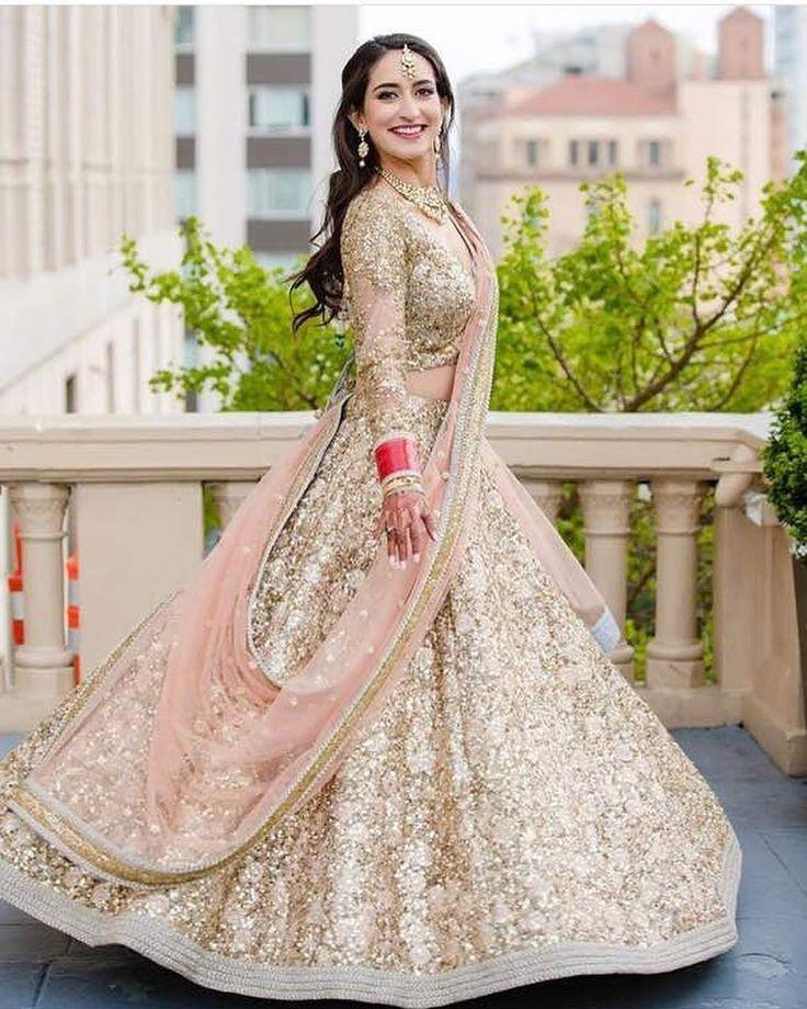 Happy and twirling brides are our favourite part of weddings! #indianbride #bridallehenga #lehengainspiration #sabyasachilehenga #goldenlehenga #shaadisaga