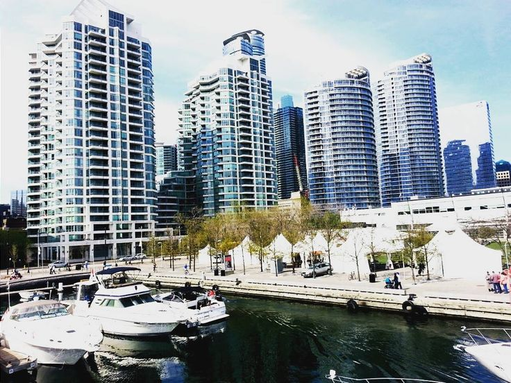 Condos and boats view from the little bridge on the harbourfront Toronto #kyack #canoe #martingoodmantrail #eden #restaurant #boat #sail #boattour #speedboat #sailboat #beaches #harbourfront #thesix #bluesky #luxury #photography #glutenfreeguide #glutenfree #ilovetoronto #fitness #travel #tourism #dine #lakeshore #condos #longboard #myphotography #passion #torontolife by holyspirittcome