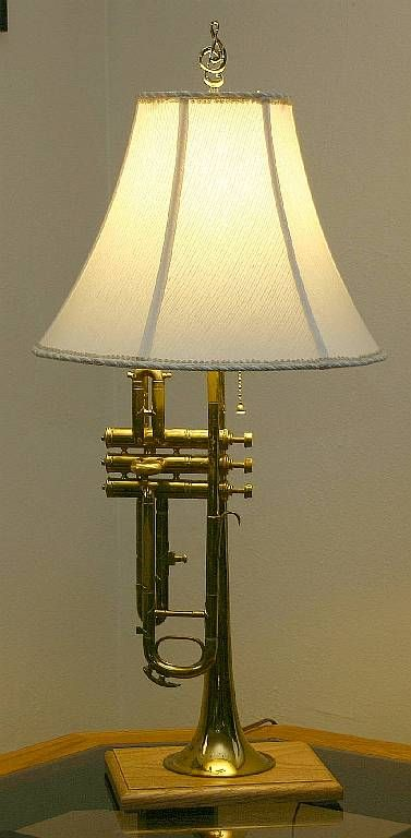 Trumpet lamp. I've been wanting to do this to one of our old trumpets for years! It's on my summer to-do list!:
