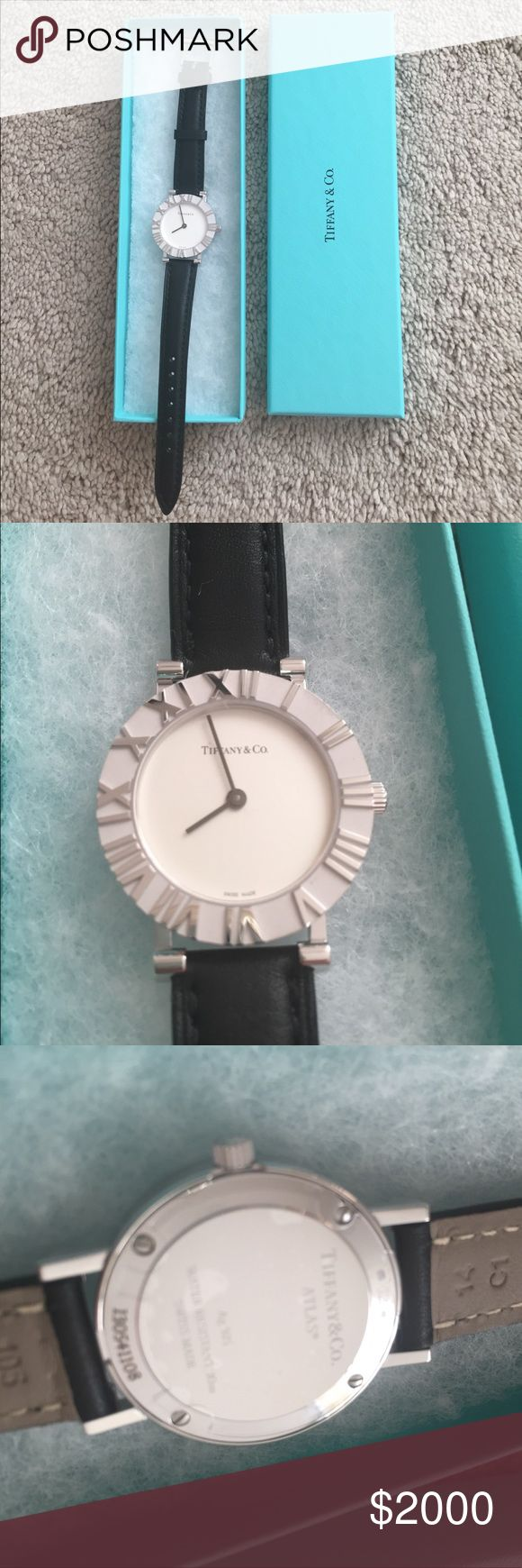 New Tiffany Watch Swiss made quartz watch with sterling silver and genuine leather straps. 29mm dial. Never worn, still has protective film on back. Comes with Tiffany shopping bag. Classy and timeless. Perfect holiday gift, won't last long. Tiffany & Co. Accessories Watches