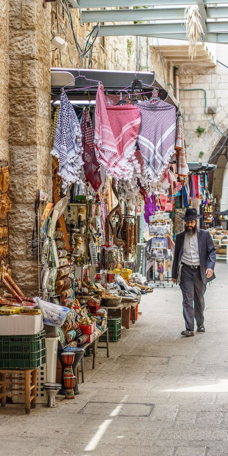 Man walking down the streets in Jerusalem, Israel. There is no shortage of tradition and history.