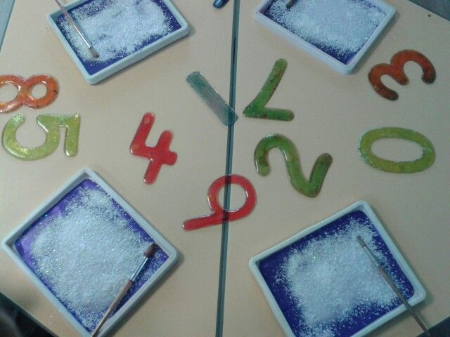 Numeral formation mark making in glittered snow