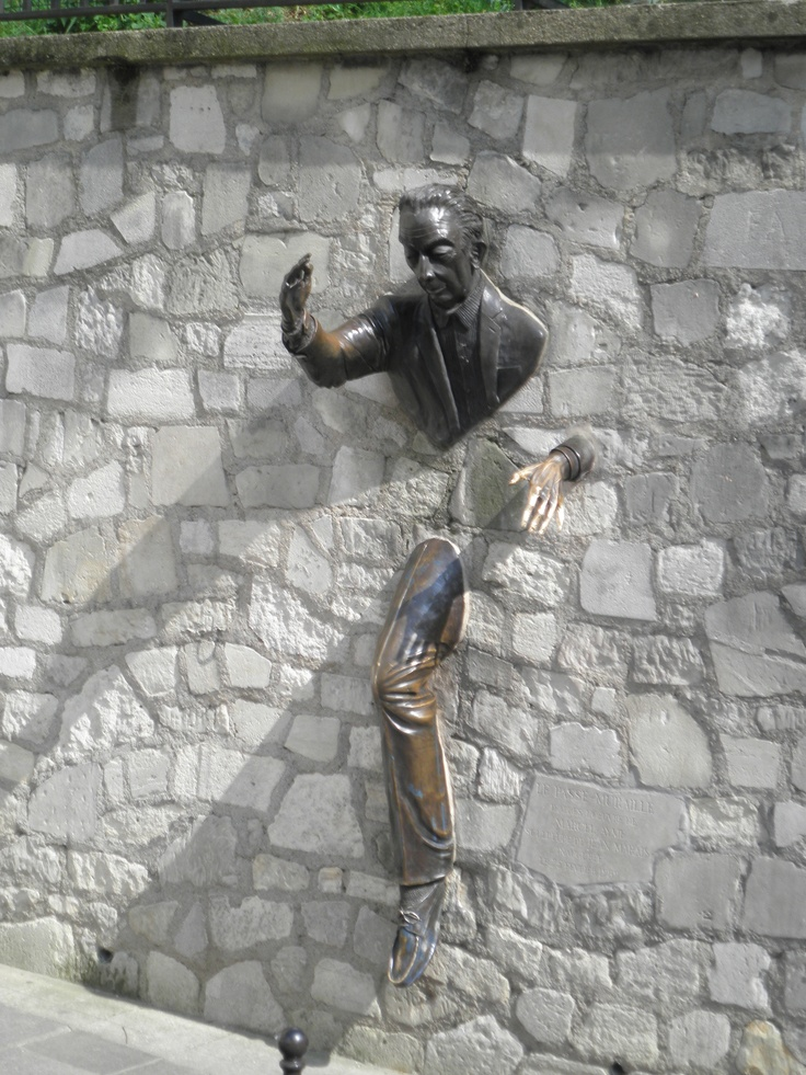 Le Passe-Muraille in Montmatre in Place Marcel Aymé. The statue is based on a short story written by  Marcel Aymé about a man who possessed the power to walk through walls.