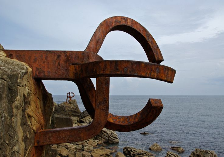 Eduardo Chillida (Spanish 1924–2002) [Abstract sculpture] The Wind Comb XV (El Peine del Viento), three steel sculptures of 10 tons each, embedded in the rocks overlooking the Cantabrian Sea, 1976. It is located at one end of the Bay of La Concha , at the end of the beach Ondarreta , in the town of San Sebastian, in the province of Guipuzcoa, in the Basque Country, Spain.
