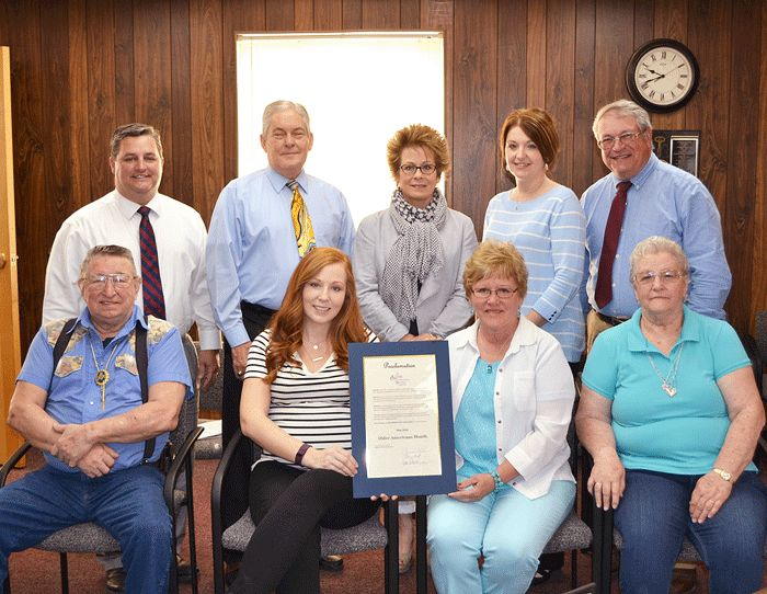 Commissioners proclaimed May 2016 as Older Americans Month in Highland County at their May 4 board meeting. Pictured are (front, l-r): Howard Kelley, Callie Reed, Susan Thornhill and Juanita Kelley; (back, l-r) Shane Wilkin, Tom Horst, Susan Rhodes, Jenni Dovyak-Lewis and Jeff Duncan. (HCP Photo/Rory Ryan)