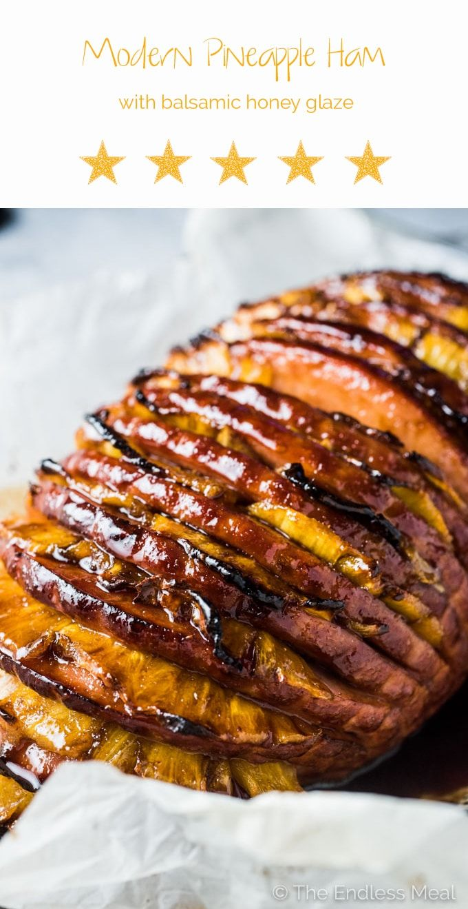 This Modern Honey Pineapple Ham is served in a fresh new way but every bit as delicious as your grandma's traditional ham. It's stuffed with pineapple slices and coated in a balsamic honey glaze then roasted to perfection. It's the perfect Thanksgiving (or Christmas or Easter) main dish recipe. | theendlessmeal.com