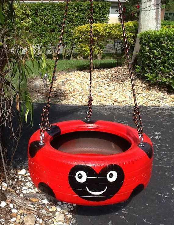 painted+tire+swings | Red ladybug hand painted Tire Swing. Drainage by Tireswingscom