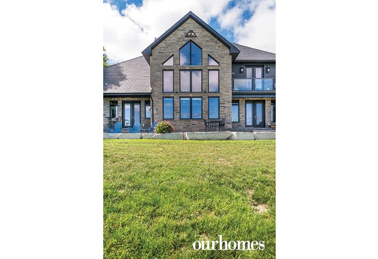 The window and door placement on the rear stone facade shows the priority was the view.  @alairhomes http://www.ourhomes.ca/articles/build/article/wake-up-to-this-sky-blue-view-from-the-edge