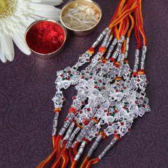 Online send sets of 12 silver rakhi for brother from sendrakhi.com  #lumbarakhi #silverrakhi #