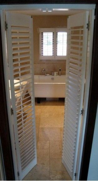 white plantation shutters as room divider