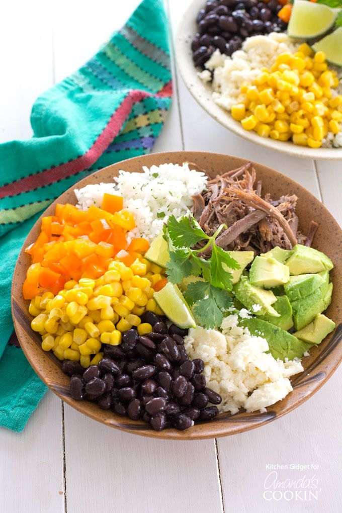 Skip the takeout and try this homemade burrito bowl instead! Layered with cilantro lime rice, beans and cheese, this quick and easy burrito bowl recipe is easily customized to your taste and full of Mexican inspired flavor.